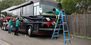 Men Cleaning Black RV
